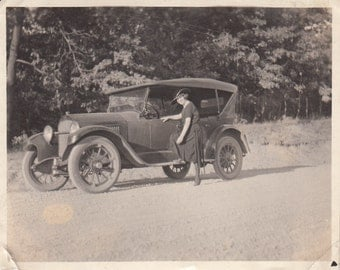 Vintage/Antique photo of a woman  and a vintage car