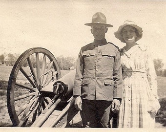 Vintage/Antique photo of a women and a man in military uniform