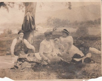 Vintage/Antique photo of  2 women, a baby and a man having a picnic