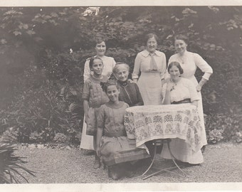 Vintage/ Antique photo of 5 women and 2 girls in different generation