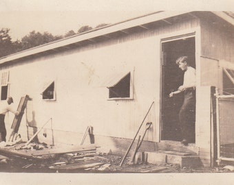 Vintage/ Antique photo of two men buidling a house.
