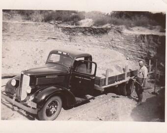 Vintage/Antique photo of a man holding a shovel