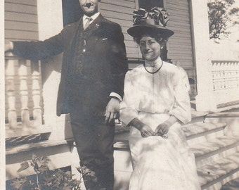 Vintage/Antique photo of a couple in a beautiful suit, dress and gorgeous hat