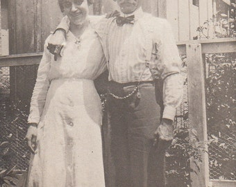 Vintage/Antique photo of a couple in adorable bowtie shirt and dress