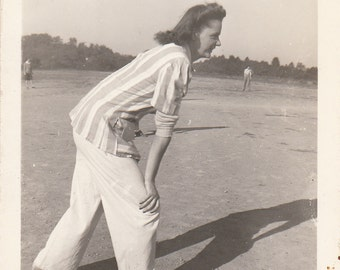 Vintage/Antique  photo of a woman playing baseball