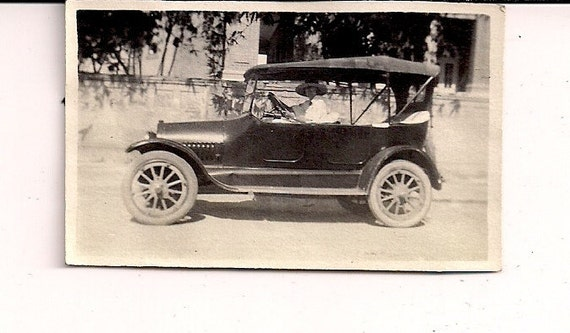 Vintage/ Antique Photo of a woman in a hat driving a vintage car