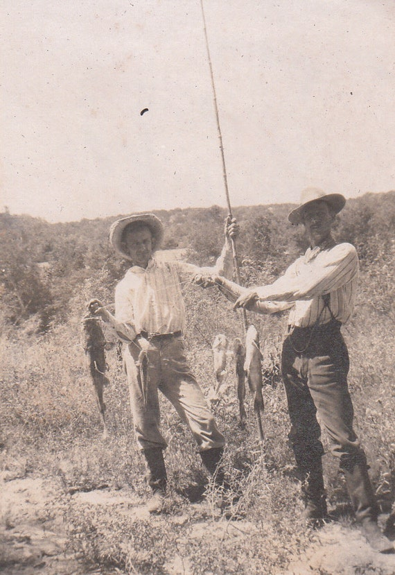 Vintage/Antique photo of 2 men showing their catch of the day  fish