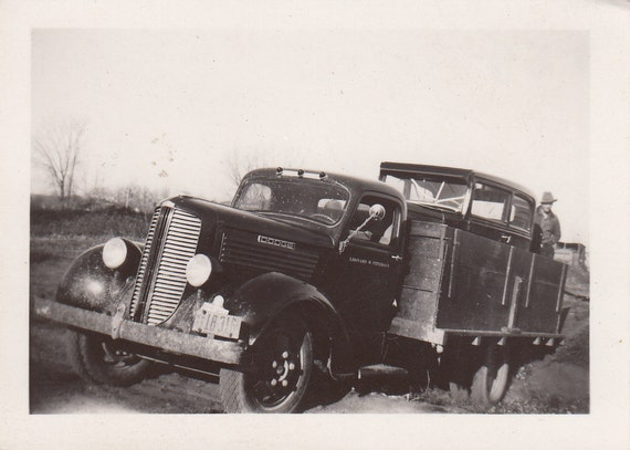 Vintage/Antique photo of a Dodge cargo truck hauling a vintage car