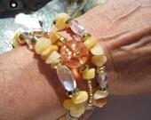Golden Quartz, Aurora Borealis Glass Crystals with pyramid and round gold tone accent bead three strand Bracelet