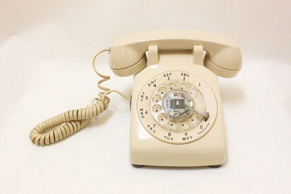 Working Condition Vintage Rotary Phone in Vintage Cream Color.