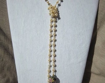 Pearl lariat- with purple floral drops.