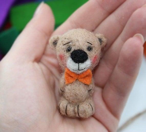 Mono.Teddy bear brooch.