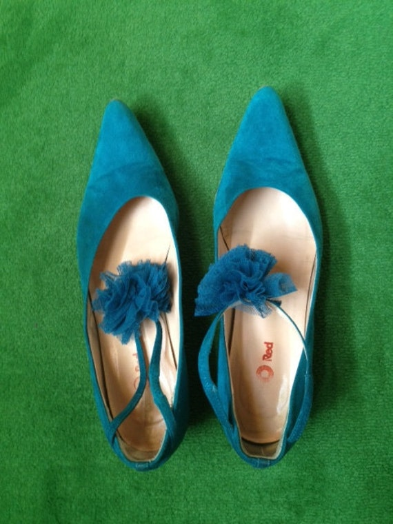 ON HOLD for Lori . Turquoise suede flat shoes with pon pon