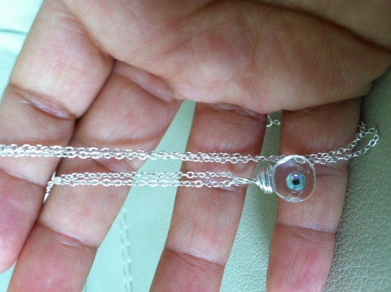 White topaz tear drop pendant with rhinestone in wire wrap in Sterling silver
