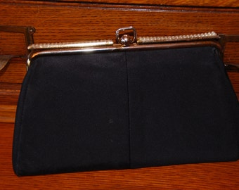 Vintage black clutch with pearl lined closure
