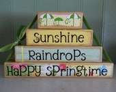 Easter and Spring Decoration wooden block stacker sunshine raindrops happy spring time yellow blue flowers umbrella