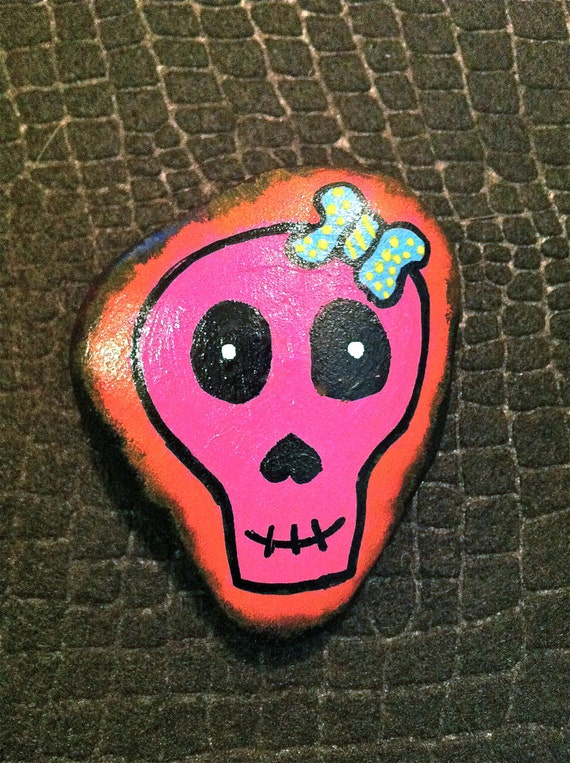 """Hand painted rock """"pink skull"""""""