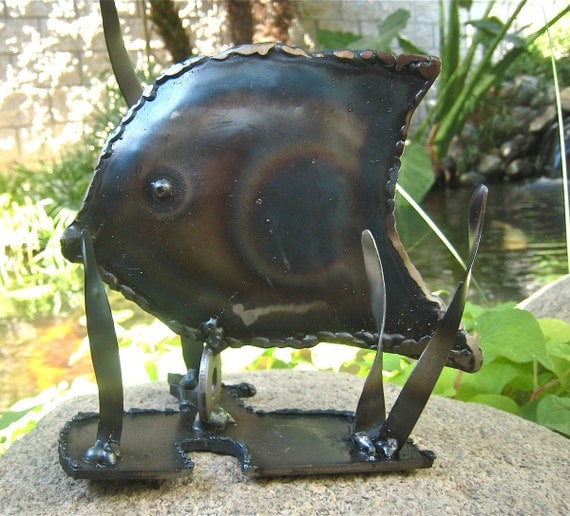 Tommy the Tang fish Metal art sculpture        He's rustic OOAK unique and he has lots of relatives waiting to be adopted