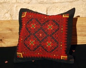 Cushion with cross-stitch embroidery