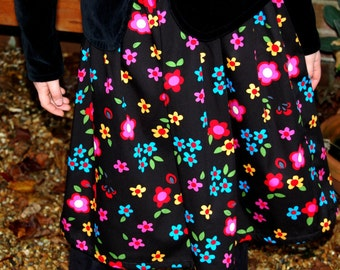 girls skirt black with bright red blue yellow pink flowers age 7 - 8 years