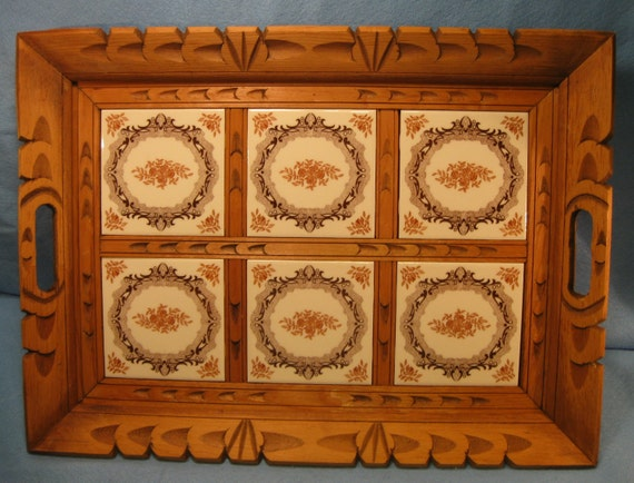 Carved wooden tray with inlaid tiles and handles