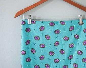 Vintage turquoise corduroy with purple pattern- 1 yard