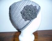Handmade Crochet Skullcap/Slouchy/flower/Beanie winter Ski Hat in light gray trimmed with one strain of darker gray and a flower