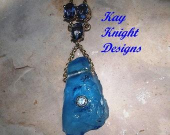 Kashmir Topaz, sapphire and diamond pendant by award winning designer Kay Knight Designs