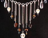 Head Hunter Necklace- Asymmetrical chain, carved skull and crystal bib necklace