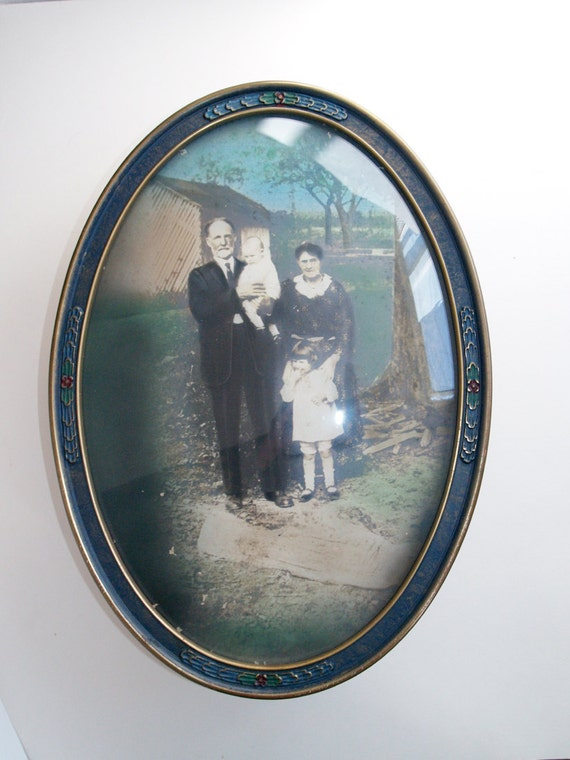 Antique Tinted Photograph in Oval Bubble glass frame NC