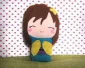 Felt smiling kokeshi doll