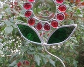 Red flower sun catcher decoration for the home or garden.