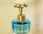 vintage 1950's glass perfum bottle with resin rose and rhinestones