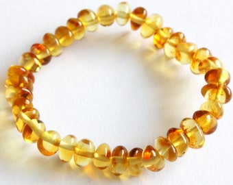 New Baltic Amber Baby Teething Anklet Baroc Form Lemon Yellow Beads on Rubber