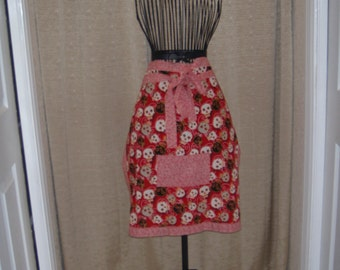 Multi Skulls Apron red black gray tumbling skulls with butterfly detail