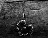 Dangerous Love, a handcrafted pendant.