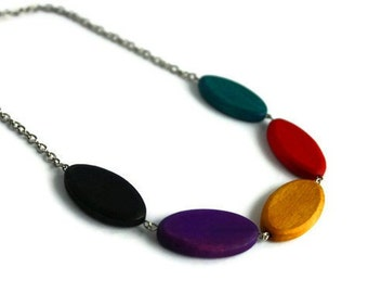 Chunky beaded necklace. Oval wood beads in jewel tone.
