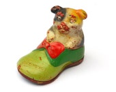 Vintage Pencil Sharpener. Weathered and worn dog in shoe. Green yellow red chipped Old School Accessory
