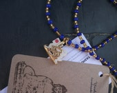 Blue beaded amulet necklace, with old upcycled Singha pendant