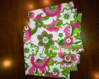 Pink and green floral table napkins with gold accent