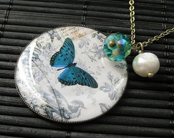Teal Butterfly Charm Necklace in Bronze with Teal Crystal Charm and Genuine Pearl. Handmade Jewelry.