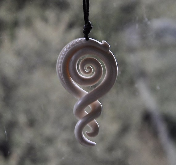 Celtic koru. Handcarved cow bone