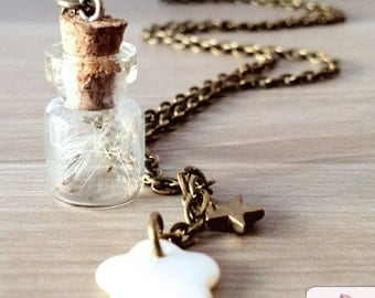Dandelion necklace. Make a wish. Dandelion inside a vial with star and shell flower. Whimsical jewelry, dreamy jewelry