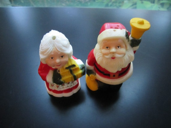 Mr. and Mrs Clause Salt and Pepper shaker Santa and wife with presents and bell plastic