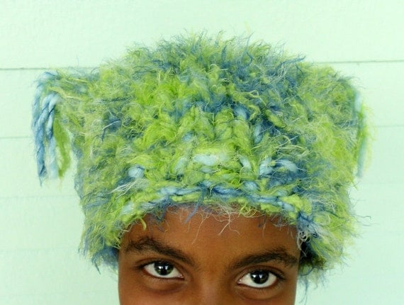 Hat is a Wild Thing, warm, cozy, soft, fluffy, chunky....okay crazy too.