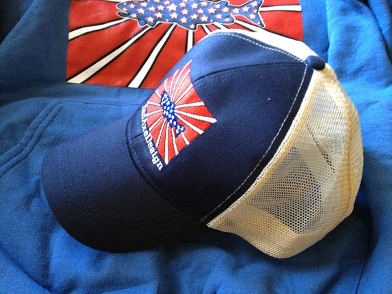 Sustainable Fly fishing trucker hat by BadAxeDesign Patriot Trout artwork by Jonathan Marquardt