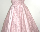 One of a kind. 50s style cocktail dress in beautifully embroidered pink taffeta and lace. Design can be made to measure. All sizes welcome.