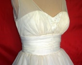 A beautifully elegant off-white 50s inspired wedding dress