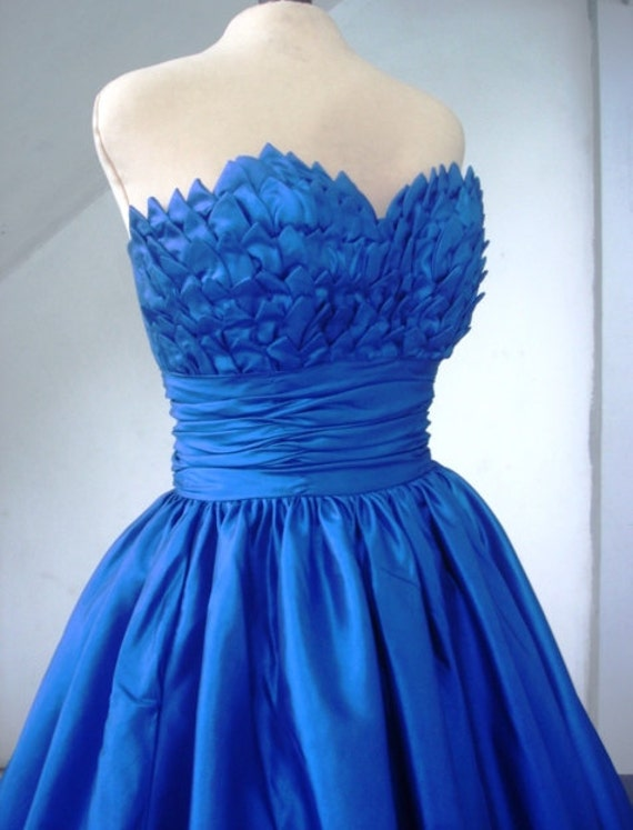 Alluring intricate, 50s inspired ball dress with beautiful bust detail inspired by blooming petals