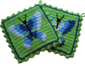Butterfly pot holders. Lime green, crochet potholders with blue ombre butterflies.  Blue butterfly decor